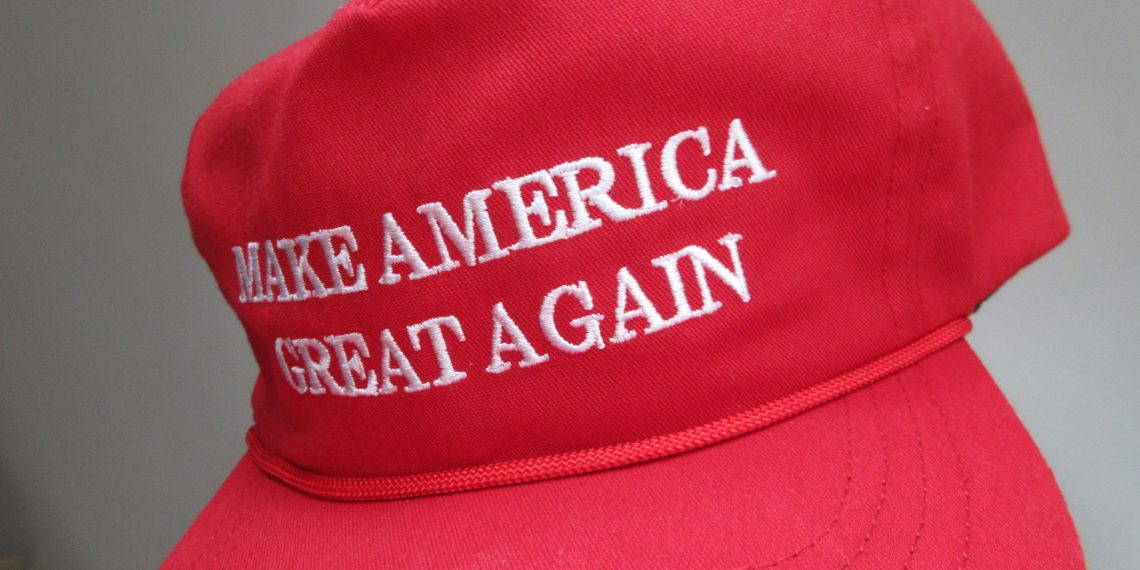 Young man wearing MAGA hat denied entry into New Zealand vigil by angry mob