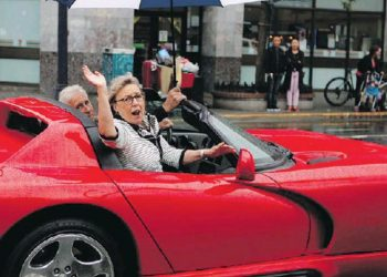 Elizabeth May parades in a gas-guzzling 1994 Dodge Viper but wants Canadians to switch to electric vehicles