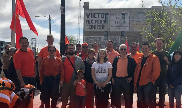Manitoba NDP Leader seen posing with Soviet flag