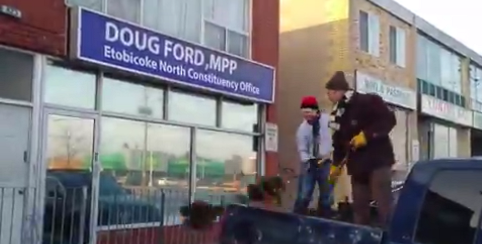 WATCH: Extinction Rebellion dumps cow manure outside Doug Ford's office