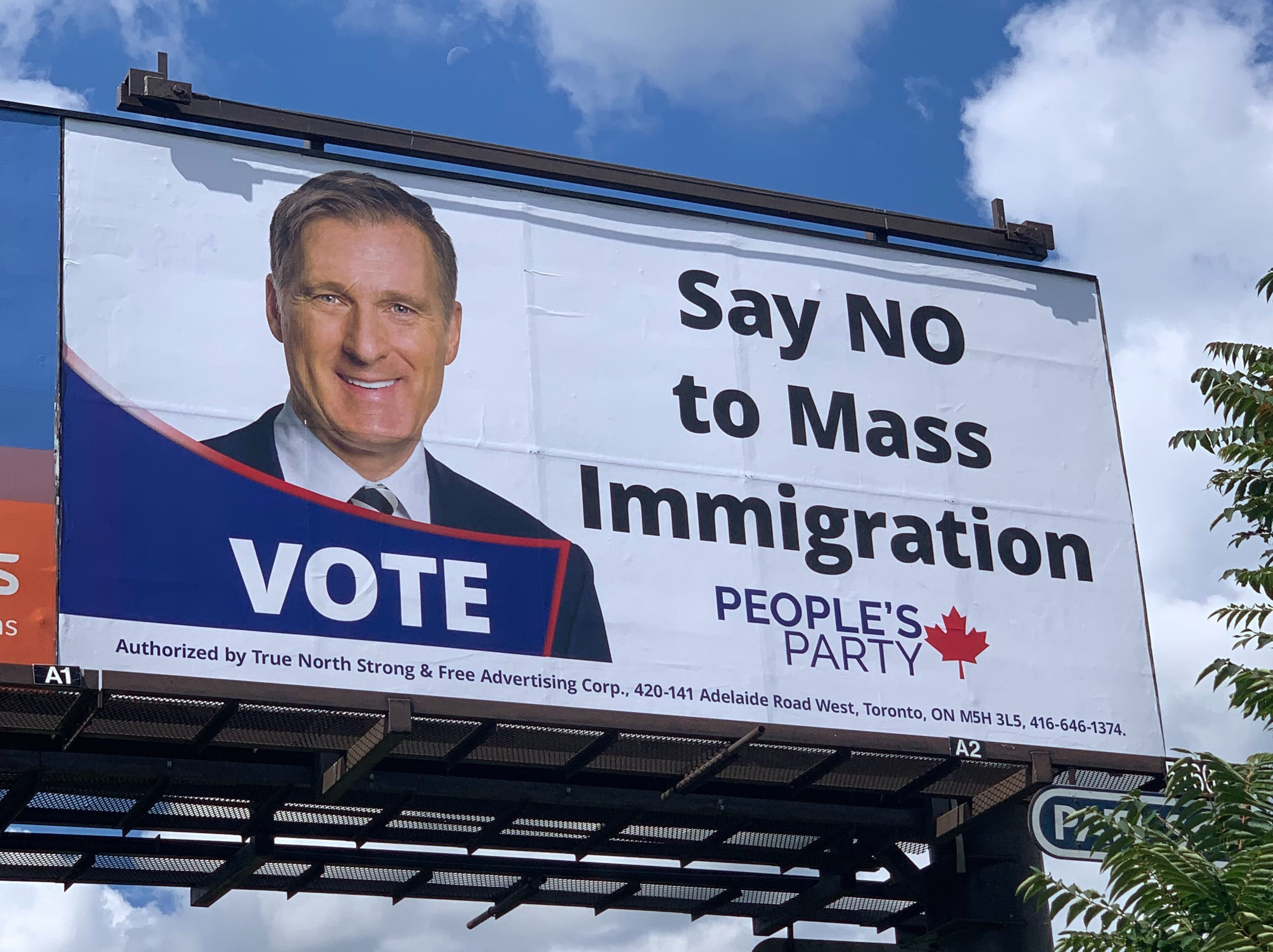 """Say NO to Mass Immigration"": PPC denies knowledge of third-party pro-Maxime Bernier billboards across Canada"