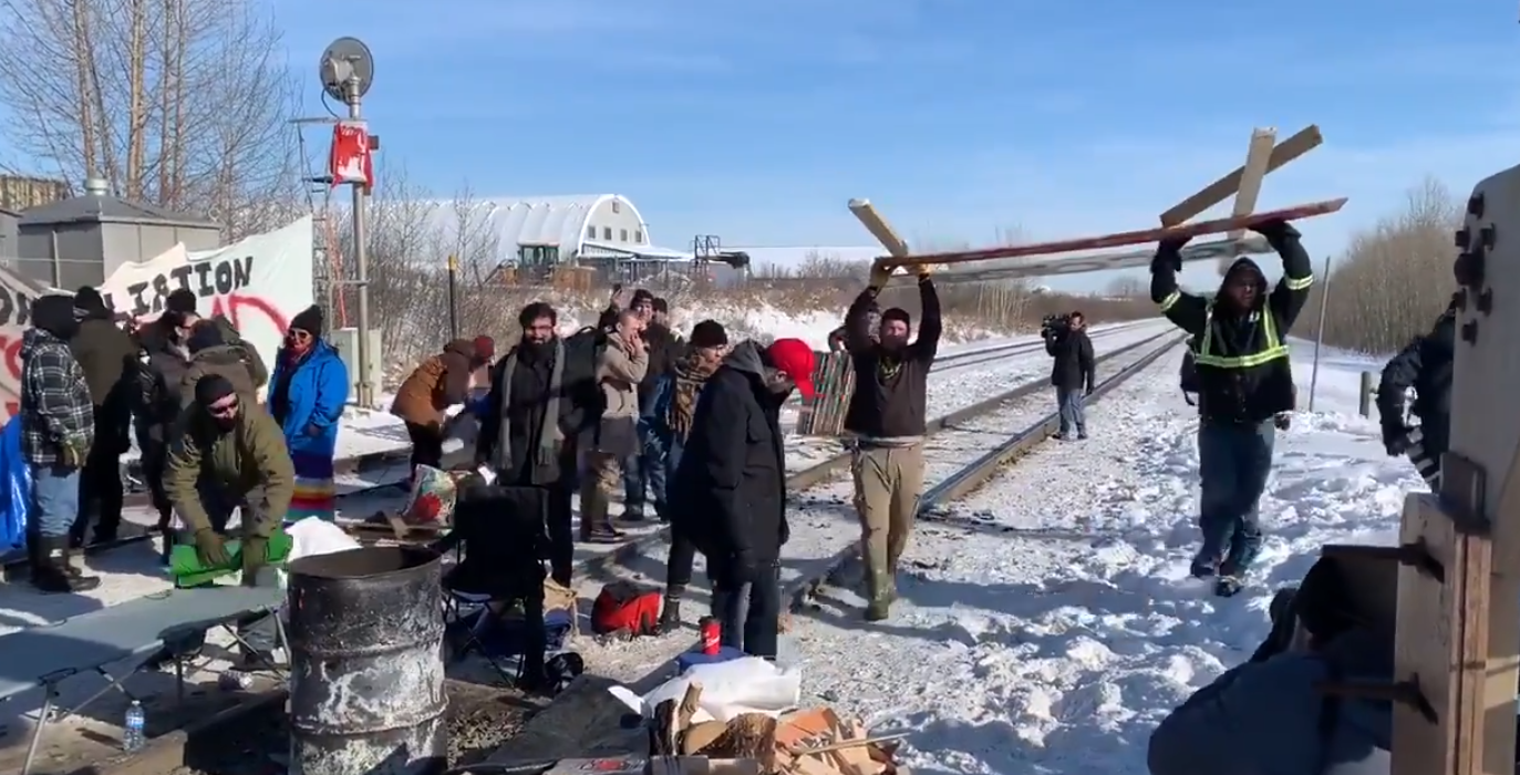 WATCH: Frustrated locals tear down anti-pipeline blockade and load it into truck