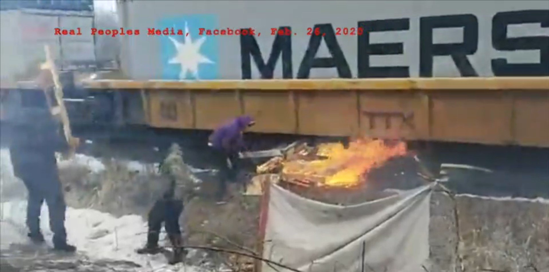 WATCH: Anti-pipeline protestors try to light train on FIRE