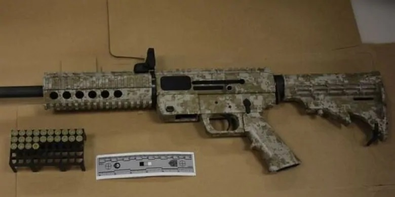 Six charged in Toronto, semi-automatic rifle seized in police raid