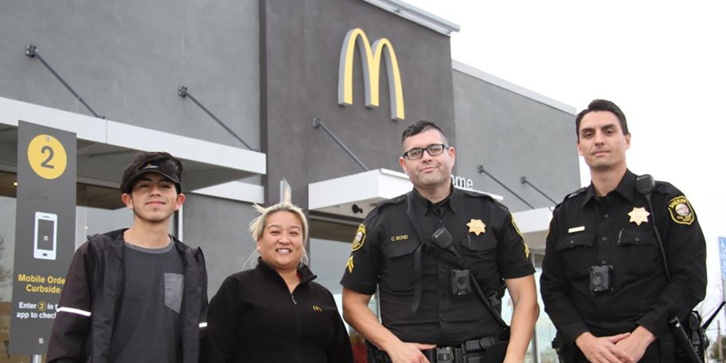 Woman mouths 'help me' to McDonald's employees, police arrest man with firearm forcing her to travel with him