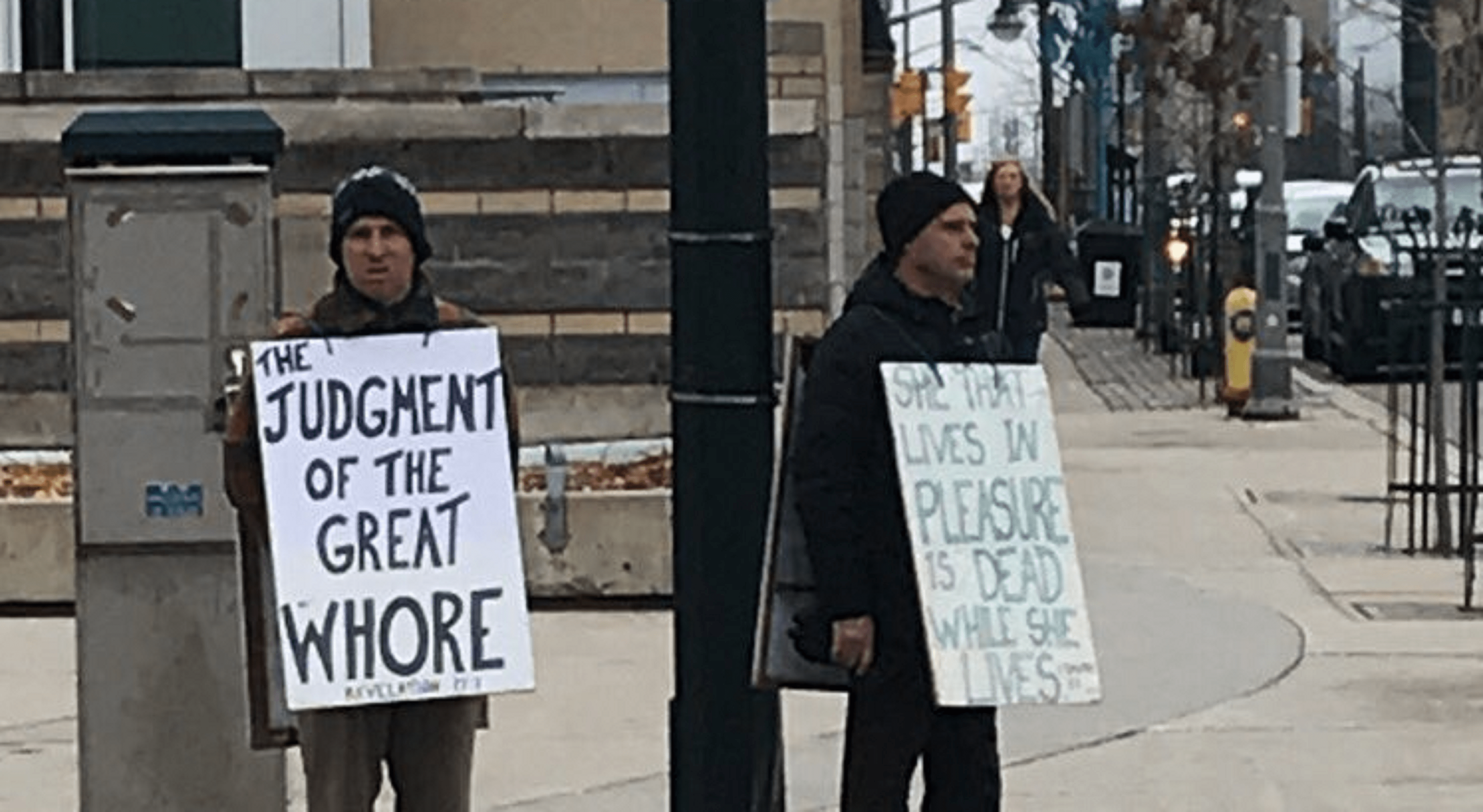 Two men wearing sandwich-board style signs are being investigated by Waterloo Regional Police. The signs had quotes from The Bible on them.