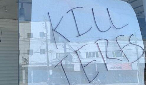 """Photos shared by the official Vancouver Rape Relief & Woman's Shelter Twitter account show several threats and messages scrawled on the centre's windows like """"KILL TERFS"""" and """"TRANS POWER."""""""