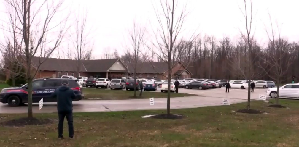Ontario church holds drive-in service while police record the proceedings