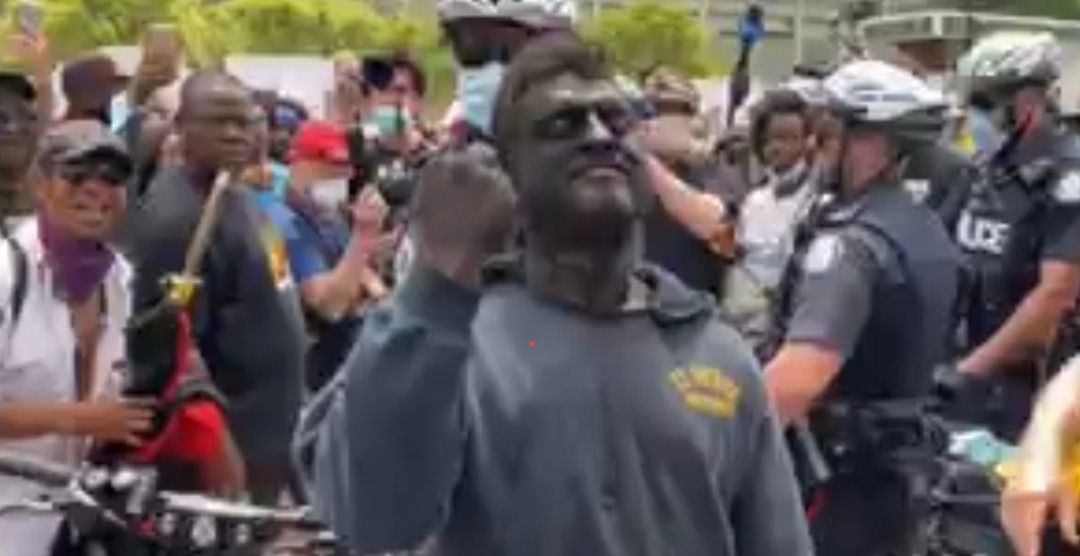 Man who wore blackface at Toronto anti-racism protest charged with 'causing a disturbance'