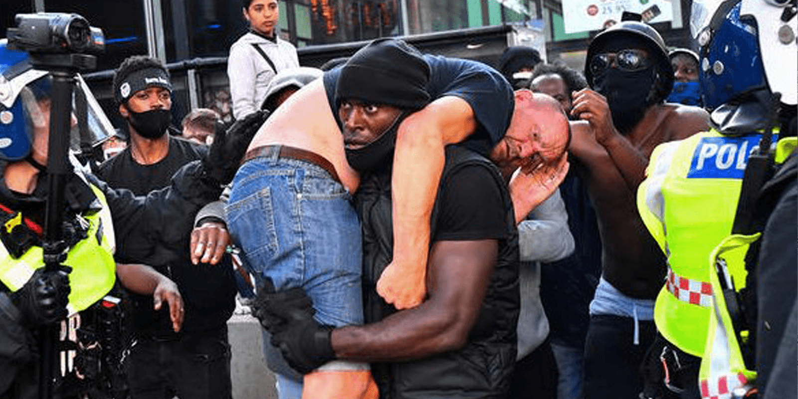 'Far-right' British protestor carried to safety by Black Lives Matter activist
