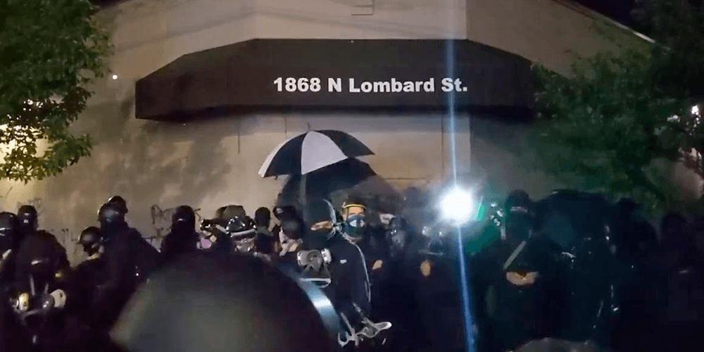 Antifa threatened to burn down Portland apartment building, set fire to police office