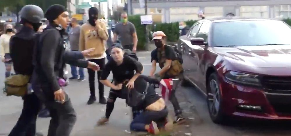 WATCH: Antifa mob pulls woman to the ground by her hair, try to steal her American flag