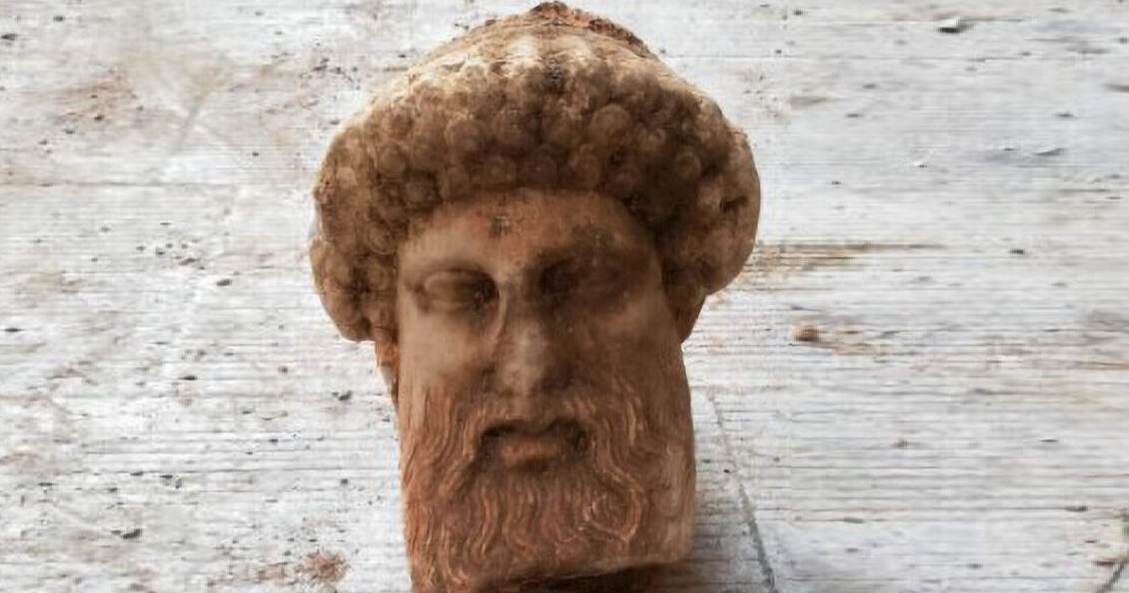 Athens road diggers find ancient carved head of Greek god