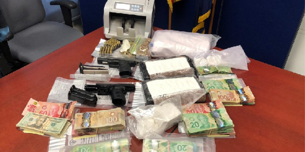 Charges laid as Ontario police seize cocaine, guns, cars and cash