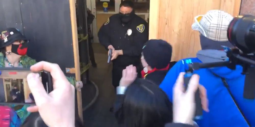 BREAKING: Antifa storm into banks in Portland; try to break inside federal courthouse