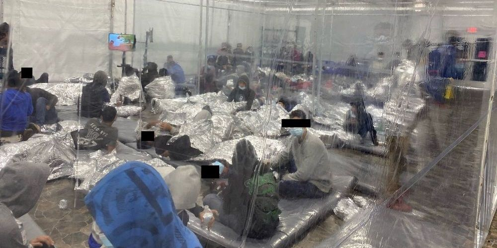 WATCH: Leaked footage shows conditions inside Biden migrant detention facility