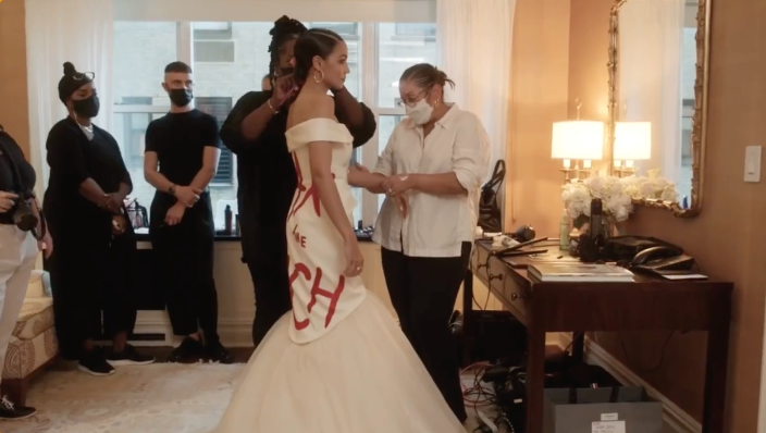 WATCH: New footage shows AOC being waited on by masked 'servant class' before Met Gala